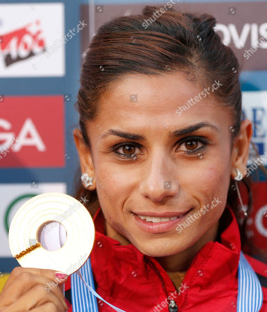 Turkey's Nevin Yanit shows the gold medal she won in the Women's 100 meter Hurdles final at the European Athletics Championships in Helsinki, Finland