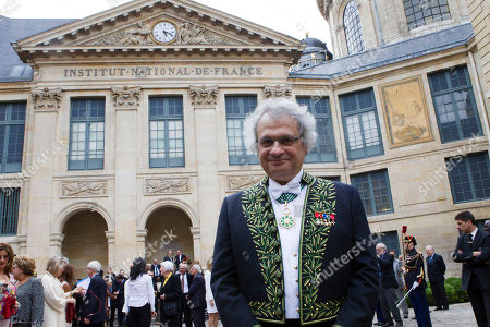 "New member of the Academie Francaise, Franco-Lebanese writer Amin Maalouf poses after was inducted into the prestigious ""Academie Francaise"" on in Paris"