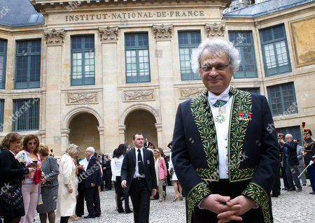 "New member of the Academie Francaise, Franco-Lebanese writer Amin Maalouf poses after he was inducted into the prestigious ""Academie Francaise"" an organization which moderates the French language on in Paris"