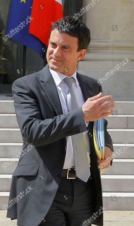 French Interior Minister Manuel Vals leaves after his weekly cabinet meeting at the Elysee Palace, Paris