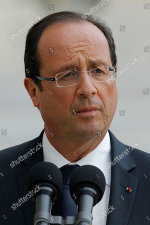 Stock Picture of French President Francois Hollande reacts with media after meeting with journalist Romeo Langlois, newly freed by Colombian rebels, at the Elysee Palace in Paris . Colombia's FARC rebels are asking France's new Socialist president for help in facilitating talks with their country's government, according to the French journalist freed from captivity in the Colombian jungles