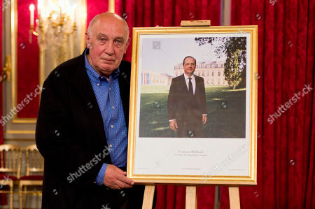 French photographer Raymond Depardon poses next to the official portrait of French President Francois Hollande he made on May, 29, 2012, after a press conference at the Elysee Palace