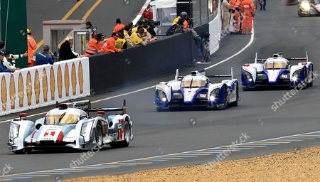 The Audi R18 TDI No1 driven by Andre Lotterer of Germany, left, and Toyota TS030 Hybrid No8 driven by Stephane Sarrazin of France, center, Toyota TS030 Hybrid No7 driven by Alexander Wurz of Germany during the 80th 24-hour Le Mans endurance race, in Le Mans, western France