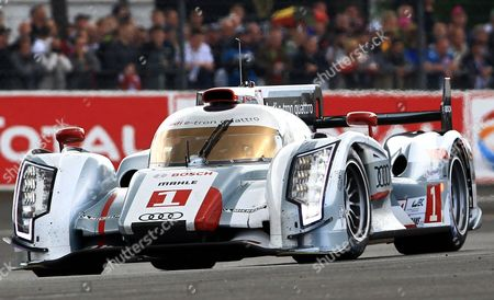 The Audi R18 TDI No1 driven by Alexander Wurz of Germany steers his car in a curve during the 80th 24-hour Le Mans endurance race, in Le Mans, western France