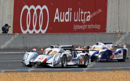 The Audi R18 TDI No2 driven by Allan Mac Nish, left, and the Toyota TS030 Hybrid No8 driven by Alexander Wurz of Germany in action during the 80th 24-hour Le Mans endurance race, in Le Mans, western France