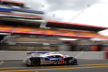 The Toyota TS 030 Hybrid driven by Alexander Wurz of Austria, Nicolas Lapierre of France and Kazuki Nakajima of Japan powers in the pit lane during the free practice session of the 80th 24-hour Le Mans endurance race, in Le Mans, western France, . The race will begin on Saturday, June 16