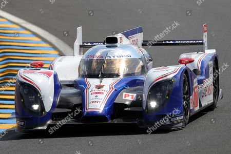 The Toyota TS 030 Hybrid driven by Alexander Wurz of Austria, Nicolas Lapierre of France and Kazuki Nakajima of Japan is seen in action during the free practice session of the 80th 24-hour Le Mans endurance race, in Le Mans, western France, . The race will begin on Saturday, June 16