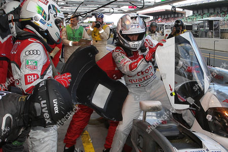 Rinaldo Capello, Allan McNish Audi's n°2 driver Rinaldo Capello of Italy leaves the car as his teammate Allan McNish of Scotland replaces him during the 80th 24-hour Le Mans endurance race, in Le Mans, western France