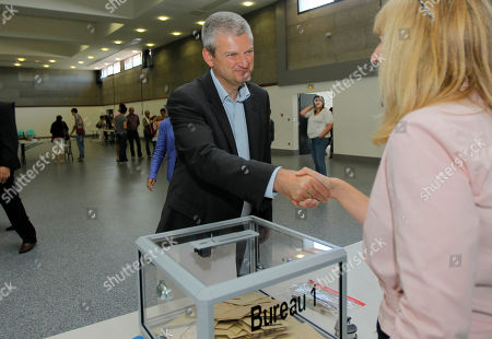 French Socialist candidate Olivier Falorni votes at the legislative elections, in Neuil sur Mer near La Rochelle, west of France. Falorni is facing a Royal opponent in the second round election, and will determine the makeup of the new parliament