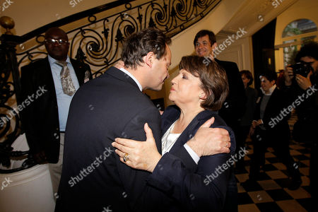 Martine Aubry, Jean Marc Germain French Socialist Party first secretary Martine Aubry kisses Socialist Party Chief of Staff Jean Marc Germain after her speech to comment the results of the first round of legislative elections in Paris, France, . French voters are going to the polls in legislative elections for the lower house of parliament, which will determine whether new President Francois Hollande's Socialists or rival conservatives control the government