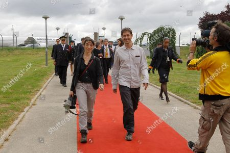 Stock Image of French journalist Romeo Langlois, newly freed by Colombian rebels, right, arrives at Paris Roissy airport, . The 35-year-old journalist was accompanying Colombian soldiers on a cocaine-lab destruction mission on April 28 when rebels attacked.women at left is his companion Pascale Mariani