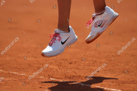 Victoria Azarenka of Belarus kicks up some clay as she serves in her first round match against Alberta Brianti of Italy at the French Open tennis tournament in Roland Garros stadium in Paris