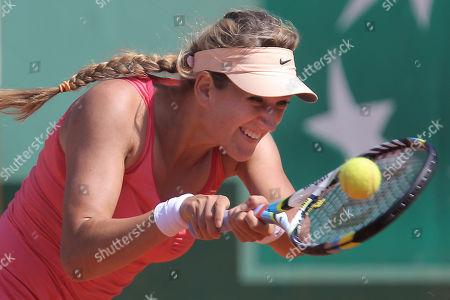 Victoria Azarenka of Belarus returns in her first round match against Alberta Brianti of Italy at the French Open tennis tournament in Roland Garros stadium in Paris