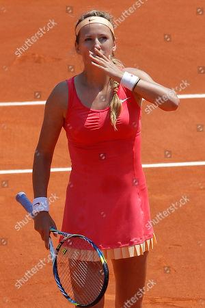 Victoria Azarenka of Belarus throws a kiss hand to fans after winning her first round match against Alberta Brianti of Italy at the French Open tennis tournament in Roland Garros stadium in Paris, . Azarenka won in three sets 6-7, 6-4, 6-2