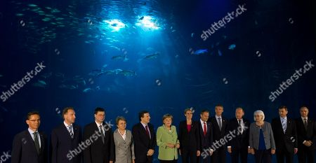 Jyrki Katainen, Igor Shuvalov, Valdis Dombrovskis, Valentina Pivnenko, Jose Manuel Barroso, Angela Merkel, Helle Thorning-Schmidt, Donald Tusk, Jens Stoltenberg, Andrius Kubilius, Johanna Sigurdardottir, Andrus Ansip, Frederik Reinfeldt The members of the Council of the Baltic Sea States pose front of a giant tank at the Ozeaneum sea museum for the family photo at their summit in Stralsund, Germany, . From left: Finland's Prime Minister Jyrki Katainen, Russian Federation's First Deputy Prime Minister Igor Shuvalov, Latvia's Prime Minister Valdis Dombrovskis, Chairman of the Baltic Sea Parliamentary Conference Valentina Pivnenko, President of the European Commission Jose Manuel Barroso, German Chancellor Angela Merkel, Denmark's Prime Minister Helle Thorning-Schmidt, Poland's Prime Minister Donald Tusk, Norway's Prime Minister Jens Stoltenberg, Lithuania's Prime Minister Andrius Kubilius, Iceland's Prime Minister Johanna Sigurdardottir, Estonia's Prime Minister Andrus Ansip and Sweden's Prime Minister Frederik Reinfeldt