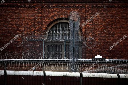 Barbed wire secures the prison Moabit where Canadian Luka Magnotta is kept in Berlin, Germany, . Luka Magnotta, 29, a Canadian porn actor suspected of murdering and dismembering a Chinese was arrested on Monday at an Internet cafe