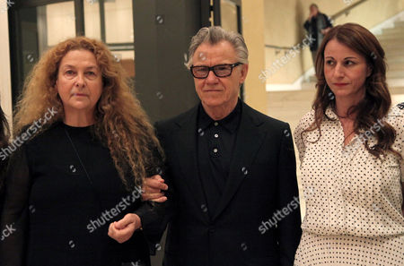 Harvey Keitel, Fivi Oikonomopoulou, Tatianna Karapanagiotou American actor Harvey Keitel, right, arrives with Fivi Oikonomopoulou, wife of Greek filmmaker Theo Angelopoulos, left, and Greek caretaker Culture Minister Tatianna Karapanagiotou, right, in Athens, on . Keitel attended a tribute for Angelopoulos who died in an accident on a movie set earlier this year