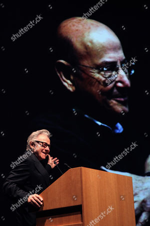 Harvey Keitel American actor Harvey Keitel gives a speech under a projected portrait of Greek filmmaker Theo Angelopoulos, in Athens on . Keitel attended a tribute for Angelopoulos who died in an accident on a movie set earlier this year