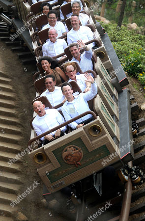 Tom Staggs, Bill Ernest Chairman of Walt Disney Parks and Resorts Tom Staggs, front right, and president and managing director of Asia for Walt Disney Parks and Resorts, Bill Ernest, front left, ride on a multidirectional terrain-style coaster with other guests at the opening ceremony of the Grizzly Gulch in the Hong Kong Disneyland
