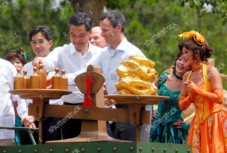 Stock Image of Tom Staggs, Leung Chun-ying Chairman of Walt Disney Parks and Resorts Tom Staggs, third right, and Hong Kong Chief Executive Leung Chun-ying, fourth right, attend the opening ceremony of the Grizzly Gulch in the Hong Kong Disneyland