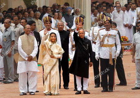 Pratibha Patil, Pranab Mukherjee Newly sworn in Indian President Pranab Mukherjee, right in foreground, who replaces Pratibha Patil, left in foreground, wave to the media as Mukherjee escorts Patil to her new home from the Presidential Palace, in New Delhi, India, . Mukherjee, 76, pledged to fight widespread poverty and work to alleviate hunger as he was sworn in Wednesday as India's 13th president in an elaborate ceremony in Parliament