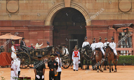 Pranab Mukherjee, Pratibha Patil New Indian President Pranab Mukherjee, left in black coat, and outgoing Indian President Pratibha Patil arrive in a traditional horse driven carriage for a guard of honor at the Presidential Palace, in New Delhi, India, . Mukherjee pledged to fight widespread poverty and work to alleviate hunger as he was sworn in Wednesday as India's 13th president in an elaborate ceremony in Parliament