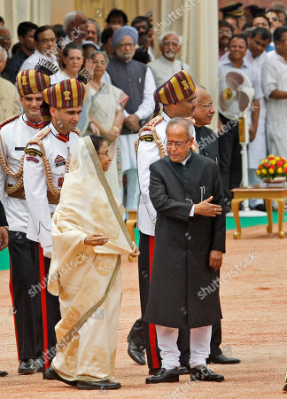 Pratibha Patil, Pranab Mukherjee New Indian President Pranab Mukherjee, right, who replaced Pratibha Patil, left, escorts her to her new home from the Presidential Palace, in New Delhi, India, . Mukherjee, 76, pledged to fight widespread poverty and work to alleviate hunger as he was sworn in Wednesday as India's 13th president in an elaborate ceremony in Parliament