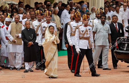Pratibha Patil, Pranab Mukherjee Former Indian President Pratibha Patil, in saree foreground, bids goodbye as she leaves the Presidential Palace after the swearing-in ceremony of Pranab Mukherjee, left in black dress, in New Delhi, India, . Mukherjee, 76, pledged to fight widespread poverty and work to alleviate hunger as he was sworn in Wednesday as India's 13th president in an elaborate ceremony in Parliament