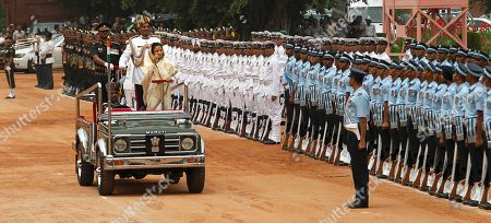 Pratibha Patil Former Indian President Pratibha Patil inspects a guard of honor at the Presidential Palace, in New Delhi, India, . Political veteran Pranab Mukherjee pledged to fight widespread poverty and work to alleviate hunger as he was sworn in Wednesday as India's 13th president in an elaborate ceremony in Parliament