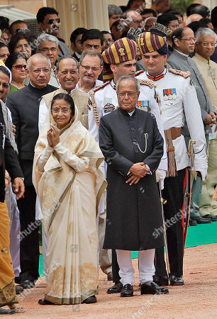 Pratibha Patil, Pranab Mukherjee Former Indian President Pratibha Patil gestures to the media as she leaves the Presidential Palace after the swearing-in ceremony of Pranab Mukherjee, right, in New Delhi, India, . Mukherjee, 76, pledged to fight widespread poverty and work to alleviate hunger as he was sworn in Wednesday as India's 13th president in an elaborate ceremony in Parliament