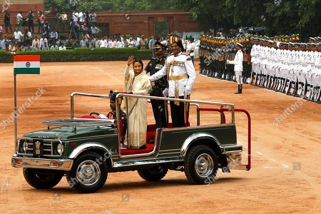 Stock Picture of Pratibha Patil Former Indian President Pratibha Patil waves after inspecting a guard of honor at the Presidential Palace, in New Delhi, India, . New President Pranab Mukherjee, 76, pledged to fight widespread poverty and work to alleviate hunger as he was sworn in Wednesday as India's 13th president in an elaborate ceremony in Parliament