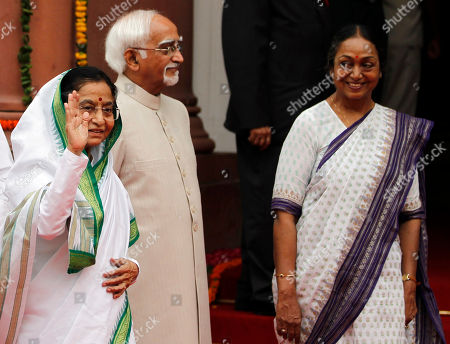 Pratibha Patil, Hamid Ansari, Meira Kumar Outgoing Indian President Pratibha Patil, left, waves to the media, as Indian Vice President Hamid Ansari, center, and Speaker of lower house Meira Kumar, right, watch as they enter the Central Hall of the Indian Parliament in New Delhi, India, . Patil addressed her farewell speech at the Parliament, Monday