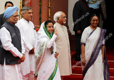 Pratibha Patil, Manmohan Singh, Hamid Ansari, Meira Kumar Outgoing Indian President Pratibha Patil, center, waves to the media, as Indian Prime Minister Manmohan Singh, left, and Vice President Hamid Ansari, second right, and Speaker of lower house Meira Kumar, right, watch as they enter the Central Hall of the Indian Parliament in New Delhi, India, . Patil addressed her farewell speech at the Parliament, Monday