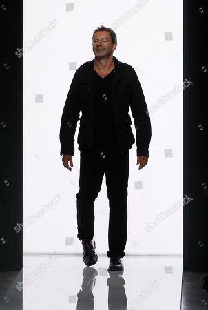 Tomas Maier Bottega Veneta creative director Tomas Maier acknowledges the applause at the end of the Bottega Veneta men's Spring-Summer 2013 collection as part of the Milan Fashion Week in Milan, Italy