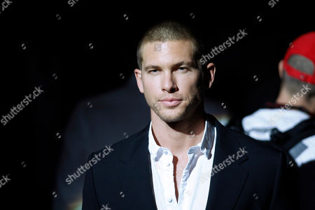 Adam Senn French top model Adam Senn poses prior to the Dolce & Gabbana fashion show, from the men's Spring-Summer 2013 collection, part of the Milan Fashion Week, unveiled in Milan, Italy