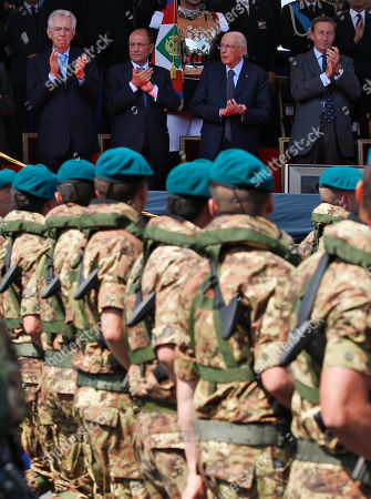 From left, Italian premier Mario Monti, Senate President Renato Schifani, Italian President Giorgio Napolitano, and Italian Lower Chamber president Gianfranco Fini watch the Republic Day military parade, in Rome