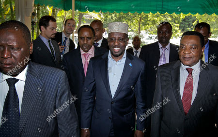 Augustine Mahiga, Sheikh Sharif Ahmed Somali President Sheikh Sharif Ahmed, center, is welcomed by UN Special Representative for Somalia Augustine Mahiga, right, on his arrival for a meeting with Somalia's political leaders in Nairobi, Kenya . Somalia's political leaders have approved a draft constitution the U.N. says was almost seven years in the making, though Somali Prime Minister Abdiweli Mohamed Ali said the constitution is only provisional until Somali citizens can vote on it, and the country's security situation doesn't yet allow for such a nation-wide vote