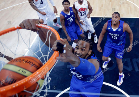 Ronny Turiaf, Boris Diaw, Mickael Gelabale France's Ronny Turiaf scores as teammates Boris Diaw and Mickael Gelabale look on during the first half of a preliminary men's basketball game against the USA at the 2012 Summer Olympics, in London