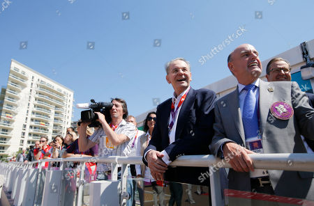 Jacques Rogge, Charles Allen IOC President Jacques Rogge, second from right, and village mayor Charles Allen, right, watch the Olympic Team Welcome Ceremony during his visit to the Athletes' Village at the Olympic Park, in London