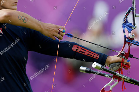 Khatuna Lorig United States' Khatuna Lorig prepares to shoot during the women's archery team competition at the 2012 Summer Olympics, in London