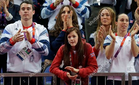 Kate, Duchess of Cambridge, second left, watches the artistic gymnastics apparatus finals along with Britain's gymnasts Kristian Thomas, left, Rebecca Tunney, center, Imogen Cairns, second right, and Elizabeth Tweddle, right, at the 2012 Summer Olympics, in London