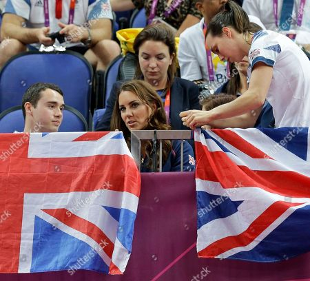 Kate, Duchess of Cambridge, center, watches the artistic gymnastics apparatus finals along with Britain's gymnasts Kristian Thomas, left, and Elizabeth Tweddle, right, at the 2012 Summer Olympics, in London