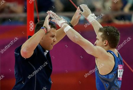 U.S. gymnast Jonathan Horton, right, celebrates with a team member after his performance on the horizontal bar during the Artistic Gymnastics men's qualification at the 2012 Summer Olympics, in London