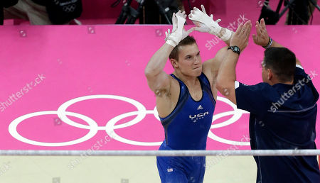 U.S. gymnast Jonathan Horton greets an unidentified person during the Artistic Gymnastics men's qualification round at the 2012 Summer Olympics, in London
