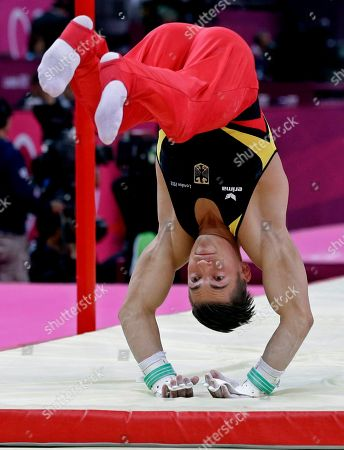 German gymnast Philipp Boy falls off the uneven bars during the Artistic Gymnastic men's team final at the 2012 Summer Olympics, in London