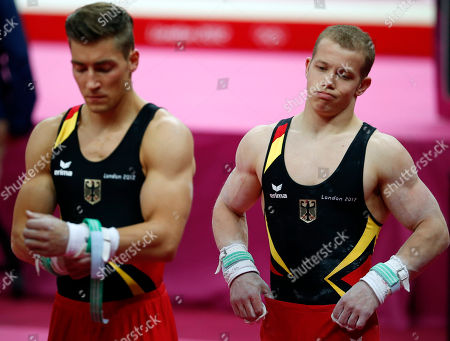 German gymnasts Fabian Hambuchen, right, and Philipp Boy wait to perform during the Artistic Gymnastics men's qualification at the 2012 Summer Olympics, in London