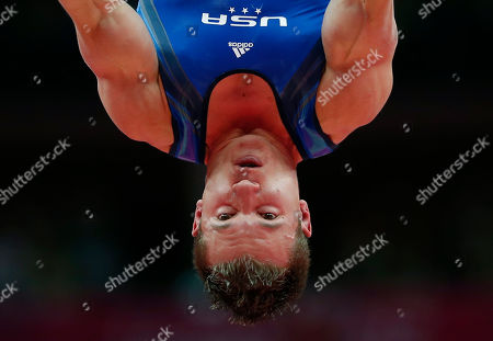 U.S. gymnast Jonathan Horton performs on the rings during the Artistic Gymnastics men's qualification at the 2012 Summer Olympics, in London