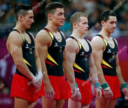 German gymnasts Marcel Nyugen, Philipp Boy, Fabian Hambuchen, and Sebastian Krimmer, left to right, stands as a team during the Artistic Gymnastics men's qualification at the 2012 Summer Olympics, in London