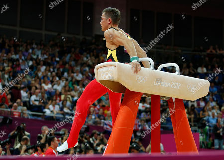 German gymnast Philipp Boy tumbles off the pommel horse during the Artistic Gymnastic men's team final at the 2012 Summer Olympics, in London