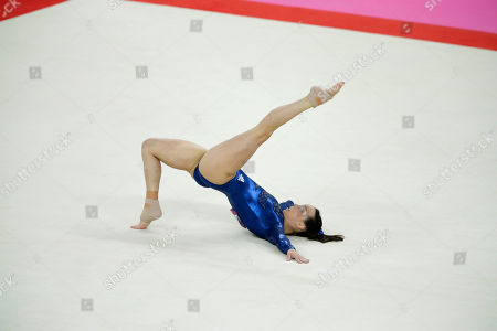 Gymnast Elizabeth Tweddle from Britain performs on the floor during the Artistic Gymnastic women's team final at the 2012 Summer Olympics, in London